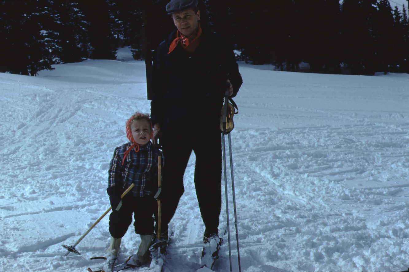 Vintage photo of a girl and her father on the ski slopes