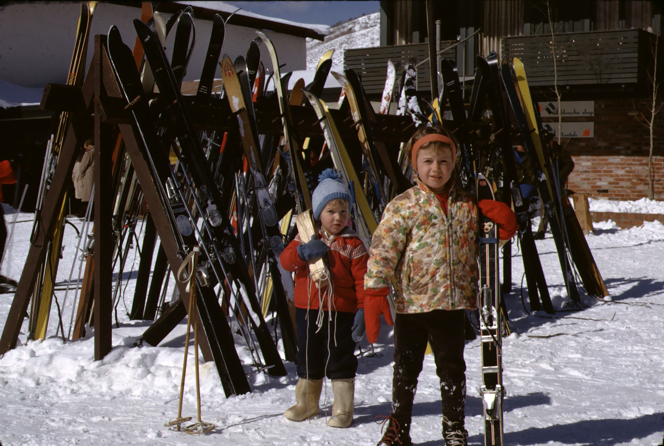 Vintage Color photo of two small girls preparing to ski at Vail Lodge, Colorado, shot by W. R. Allen